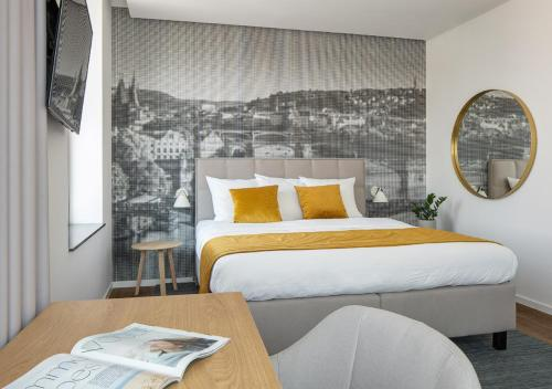 Cama o camas de una habitación en Mamaison Residence Downtown Prague