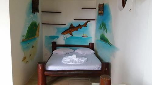 A bed or beds in a room at Morro Beach Hotel