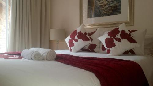 A bed or beds in a room at The Club House Guest House