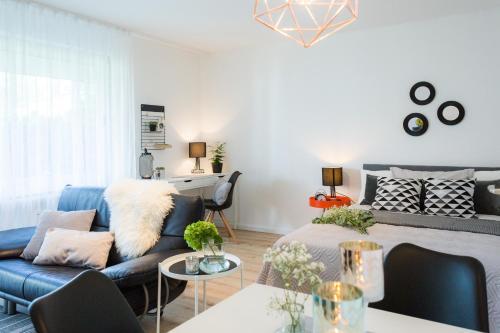 Ein Sitzbereich in der Unterkunft Holiday Appartement »Achalm« mit Sonnenterrasse