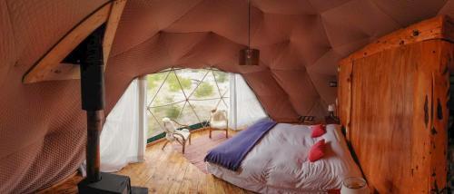 Una cama o camas en una habitación de Patagonia Eco Domes