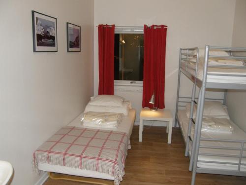 A bunk bed or bunk beds in a room at Nordkapp Vandrerhjem Hostel