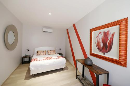 A bed or beds in a room at Le Porta 5