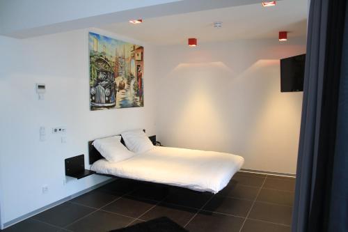 Cama o camas de una habitación en Hotel Grey