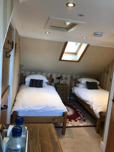 A bed or beds in a room at The Moorings