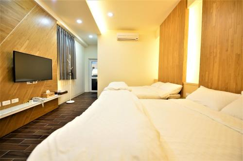 A bed or beds in a room at 日晴民宿 Sun Day