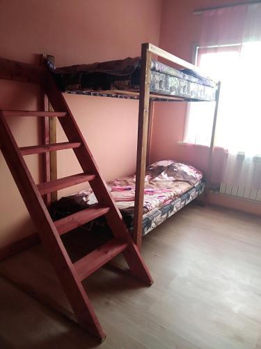 Двухъярусная кровать или двухъярусные кровати в номере Абажур