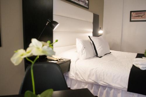 Cama o camas de una habitación en Pocitos Plaza Hotel