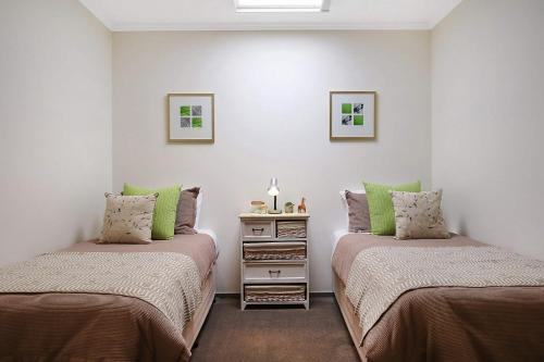 A bed or beds in a room at Marctime - Woodlands