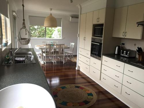 A kitchen or kitchenette at Nobbys Beach House