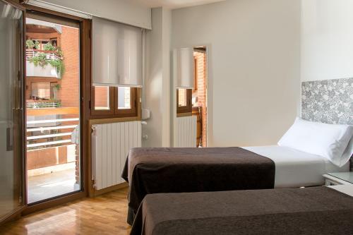 Cama o camas de una habitación en Pensión Laurel