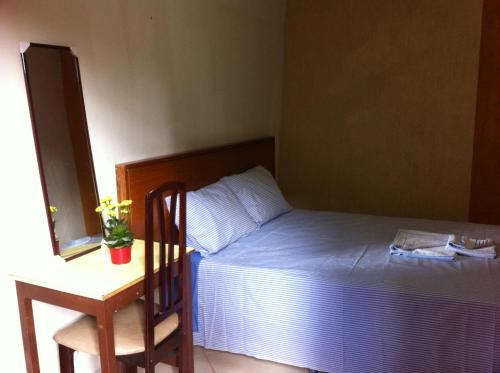 Cama ou camas em um quarto em Pousada Del Rey