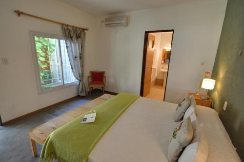Una cama o camas en una habitación de Casa Lila