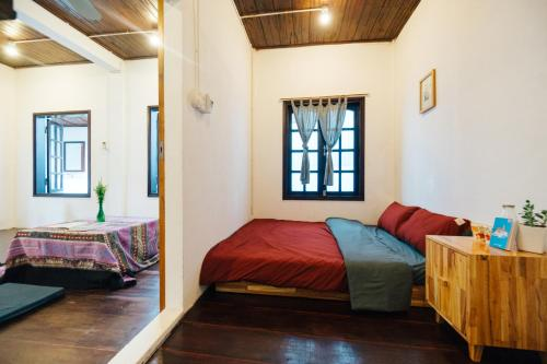 A bed or beds in a room at a-mâze house