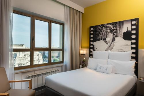 A bed or beds in a room at NYX Hotel Milan by Leonardo Hotels