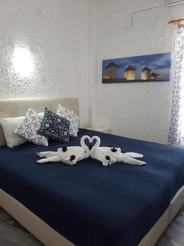 A bed or beds in a room at Aegialis Studios & Rooms