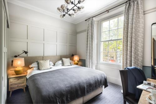 A bed or beds in a room at Ardgowan Hotel