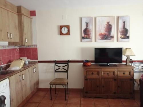 A kitchen or kitchenette at Apartamentos Rurales Carlos