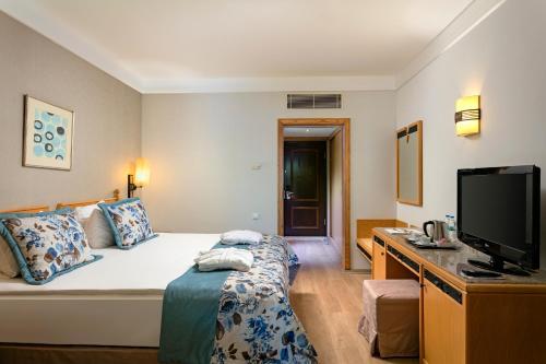 Ein Bett oder Betten in einem Zimmer der Unterkunft Xanadu Resort Hotel - High Class All Inclusive
