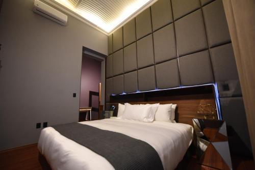 Cama o camas de una habitación en Casa Prim Hotel Boutique
