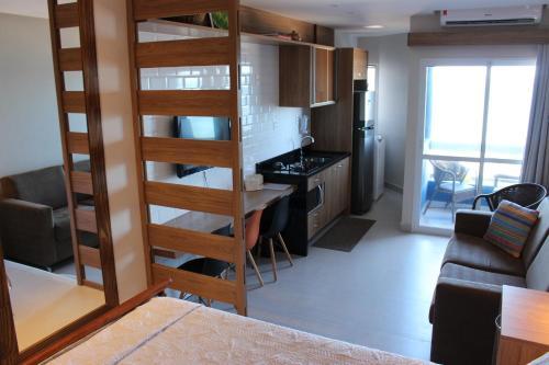 A kitchen or kitchenette at Bahia Flat Apt 302