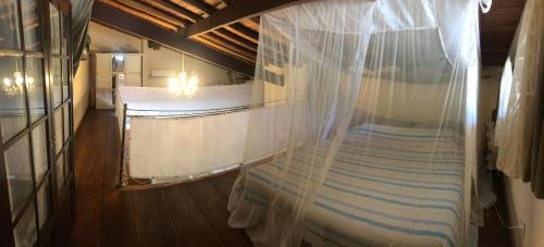 A bed or beds in a room at Tropical Village Flat