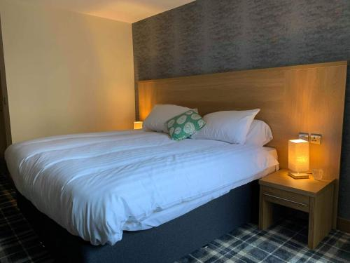 A bed or beds in a room at Odddfellows Hotel Bar and Grill