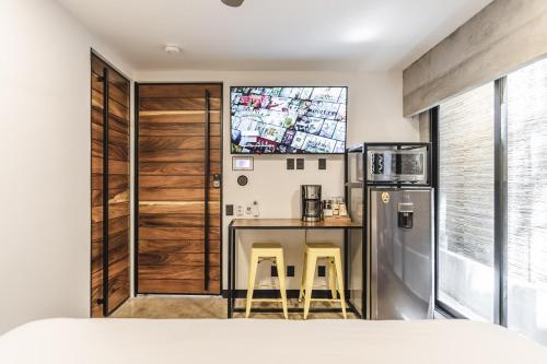 A kitchen or kitchenette at Lofts On Basilio