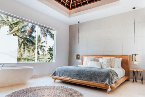 A bed or beds in a room at Kabila Villas