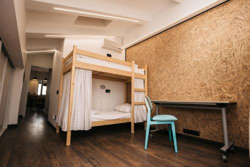 A bunk bed or bunk beds in a room at Хостел LOFT