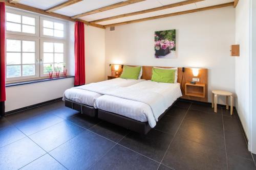Een bed of bedden in een kamer bij Spraelandhof