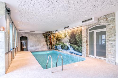 The swimming pool at or near Alpin Hotel Gudrun