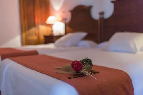 A bed or beds in a room at Dwo Convento de la Magdalena by Checkin