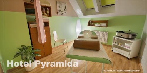 A kitchen or kitchenette at Lázeňský hotel Pyramida I