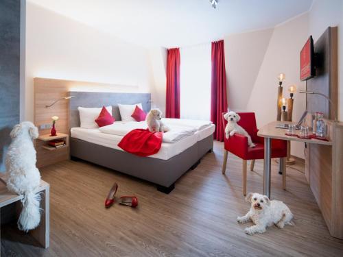A bed or beds in a room at Landhotel Fettehenne
