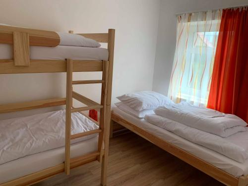 A bunk bed or bunk beds in a room at Apartmány Michaela