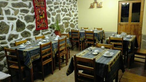 A restaurant or other place to eat at B&B Chayana Wasi