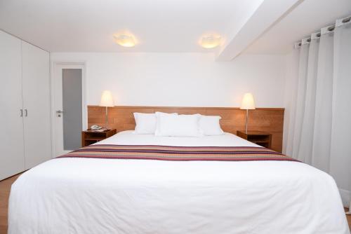 Cama o camas de una habitación en Hotel Plaza de Armas Cusco