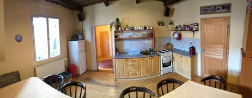 A kitchen or kitchenette at Lazy River Hostel