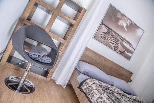 A bed or beds in a room at Wake Up Wellness Hostel