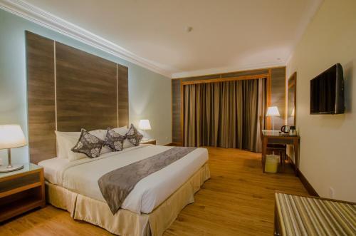 Katil atau katil-katil dalam bilik di Kingwood Hotel Sibu