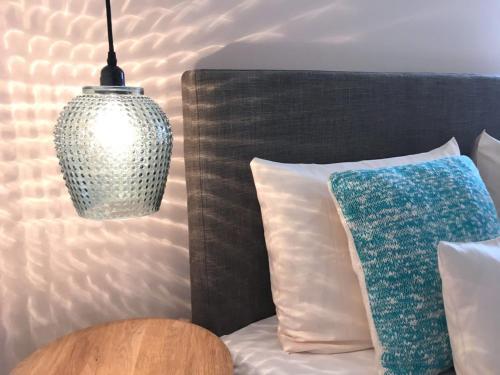 Ein Bett oder Betten in einem Zimmer der Unterkunft Flux-Biohotel Werratal