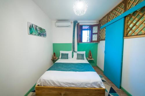 A bed or beds in a room at La Cannelia