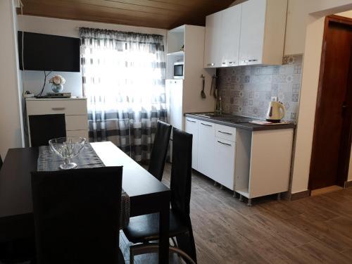 A kitchen or kitchenette at Apartments Sanja-Marino