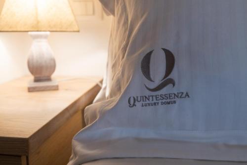 Ein Bett oder Betten in einem Zimmer der Unterkunft Quintessenza Luxury Domus