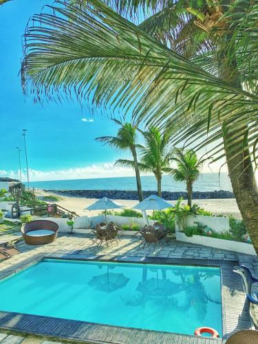 The swimming pool at or close to VOA Paraíso Natal Hotel