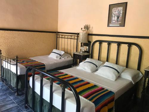 A bed or beds in a room at Casa Jesus Maria 407