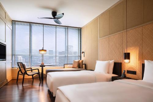 A bed or beds in a room at The RuMa Hotel and Residences