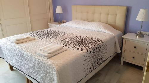 A bed or beds in a room at Townhouse Mar y Sol