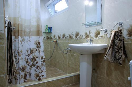 A bathroom at VAN Garden